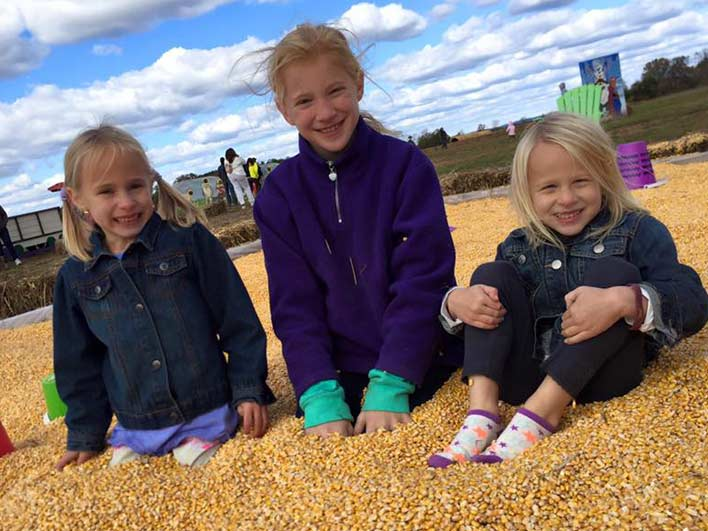 Snyder's Farm Fall Festival - Kid's Playing in Corn